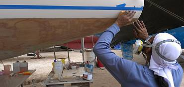 Lek sanding the gelcoat under the taped paint-line