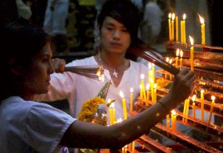 Lighting incense at Jui Tui Temple, Phuket Vegetarian Festival, Thailand