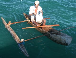 Madagascan lobsterman & dugout canoe