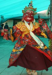 Makakala dancer in red mask