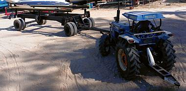 The boatyard's catamaran trailer & one of their 2 tractors