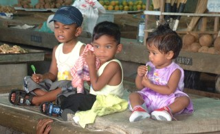 Indo-Fijian children at the market in Suva