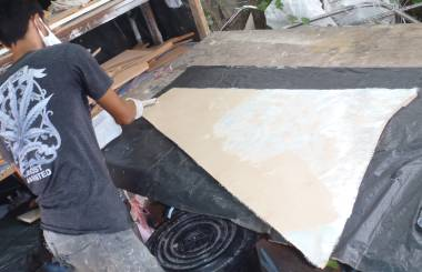 Max glassing a foam panel for the foredeck