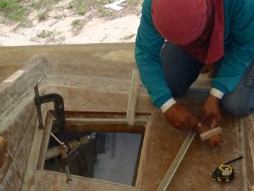 Mee fitting small gutter sections around the hatch opening