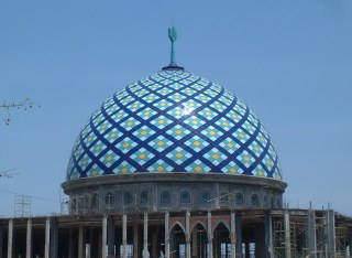 A beautiful tiled dome to top off an otherwise unfinished mosque.