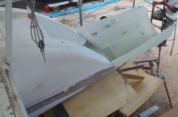Pulling the wood mold off the starboard extension