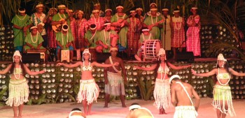 Beautiful Polynesian dancers in shell skirts