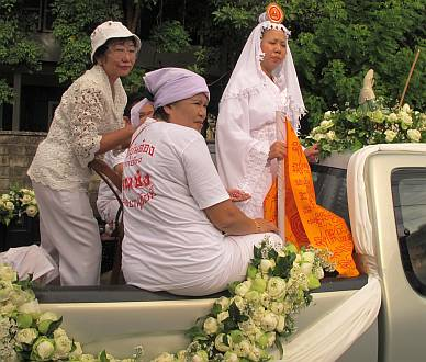 Woman ma song on a decorated float-truck