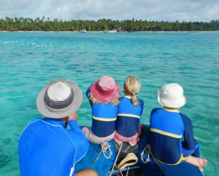 Heading for shore over clear blue water