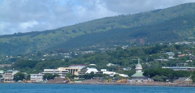 The Papeete waterfront, from near the pass, shows the built-up hills.