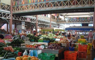 The vast two-story Papeete market sells fruits, veg, prepared foods, handicrafts.