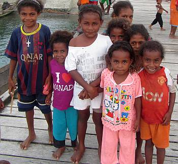 Curious kids on the dock, Salawati village