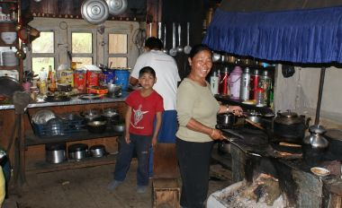 Pema helping cook in the Ringmo guesthouse kitchen