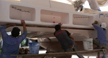 Pla, Baw, & Lek starting the long gelcoat polishing procedure