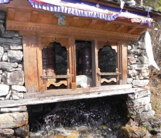 Water powered prayer wheels