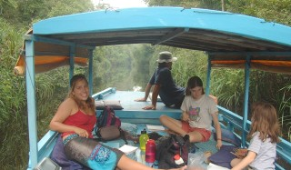 Aboard the klotok in the narrow streams of Borneo