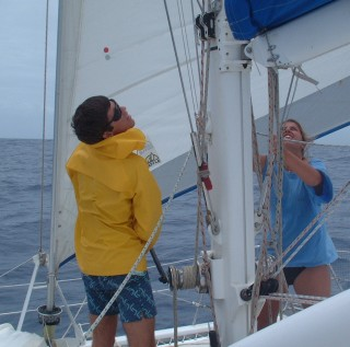 Chris and Amanda shake out a reef on a blustery sail to Savusavu.