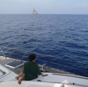 Shantha on the bow. Oil rig offshore India.