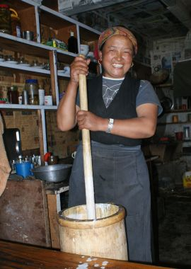 Sherpani churning butter