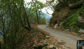 Narrow roads on steep hillsides going to Yuksam, Sikkim, India