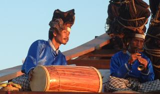 Balinese musicians on a traditional boat