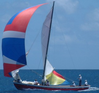 "Note the colorful ""water sail"" under the boom of the mainsail"
