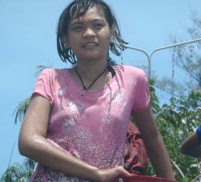 A young, cute, wet Songkran participant!