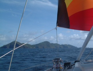 Under spinnaker south of St. Vincent, with Bequia ahead
