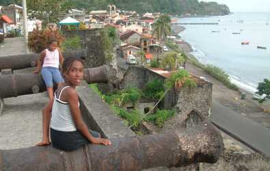 Martinique girls on the cannons above St. Pierre