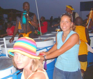 Pushing steel drums (and their players) through Grenada's streets at night