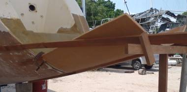 First bit of foam epoxied to our starboard transom