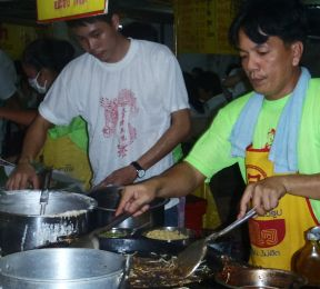 Street food vendors at the Phuket Vegetarian Festival, Thailand