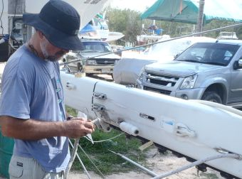Tying on nylon cord so we can pull out the Main Halyard