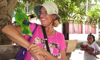 Sue with an Eclectus parrot friend