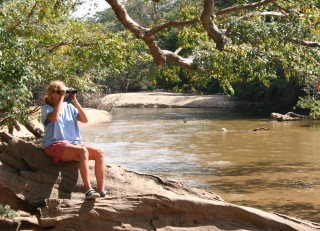 Sue birding by the river in Yala National Park