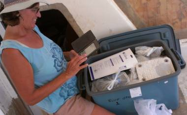 Sue sorting, organizing & recording the contents of storage boxes