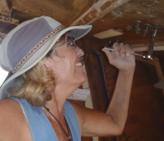 Sue removing winches from the cabin-top