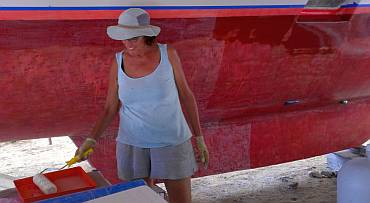 Sue rolling today's first layer of epoxy on the port hull