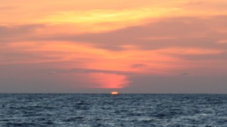 Sunset at sea, just before a green flash