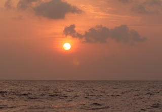 A glorious sunset on a flat sea, en route to Maldives