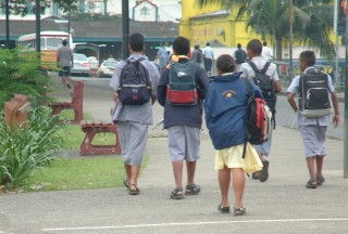 School boys wearing traditional sulus, just off the bus in Suva