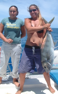 Amanda lands a nice big Brassy Trevally