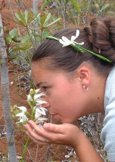 Tianna enjoying the fragrant orchids of New Caledonia