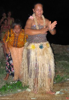 "Tongan women dance and receive money ""tips"" from the audience"