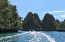 Dinghy exploring in Wayag, Raja Ampat