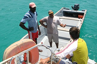 Chatting on the back of the boat.