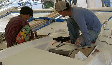 Yando and Heru putting gaskets on the new stbd tank hatch